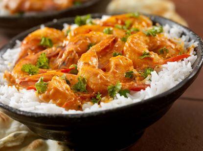 Curry de crevettes aux tomates et à la coriandre