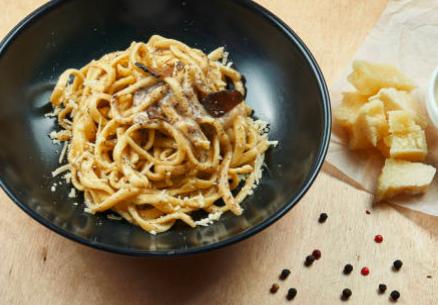 Spaghettis fromages et champignons